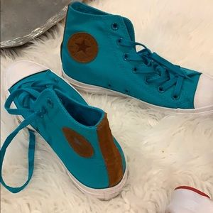 Teal and brown leather chuck Taylor's